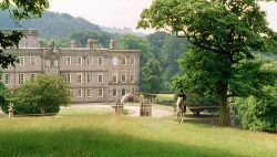 The back facade of Pemberley, with Mr. Darcy on horseback.