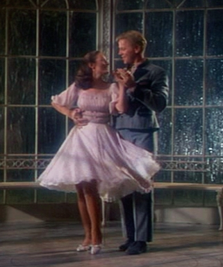 Liesl (Charmian Carr) and Rolfe (Daniel Truhitte) dancing in the gazebo in The Sound of Music.